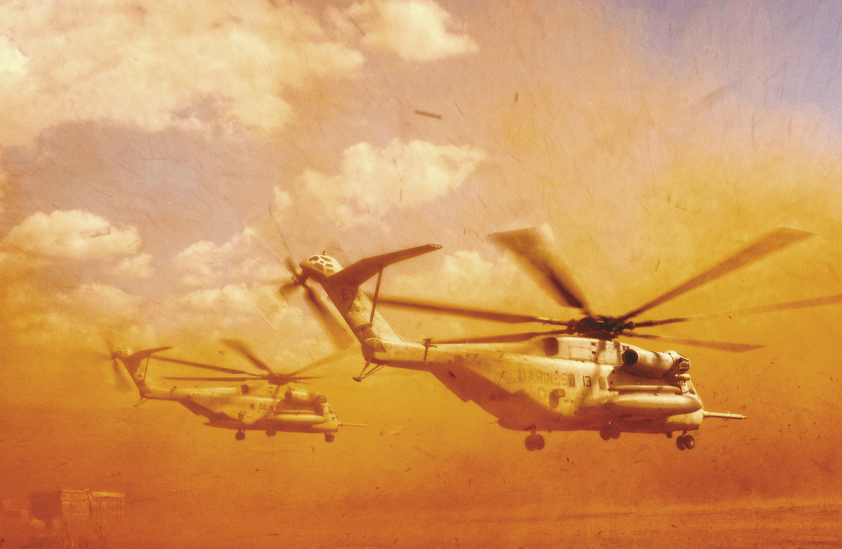 November 20, 2005:  A Marine CH-53E helicopter from the 464th Alpha Company kicks up sand and rocks as it takes off in Harar, Ethiopia. There, sailors from the Navy Mobile Construction Battalion 3 have dug three wells and are staging to drill several hand-pump wells, which will be used to provide thousands of Ethiopians and their livestock with potable water.