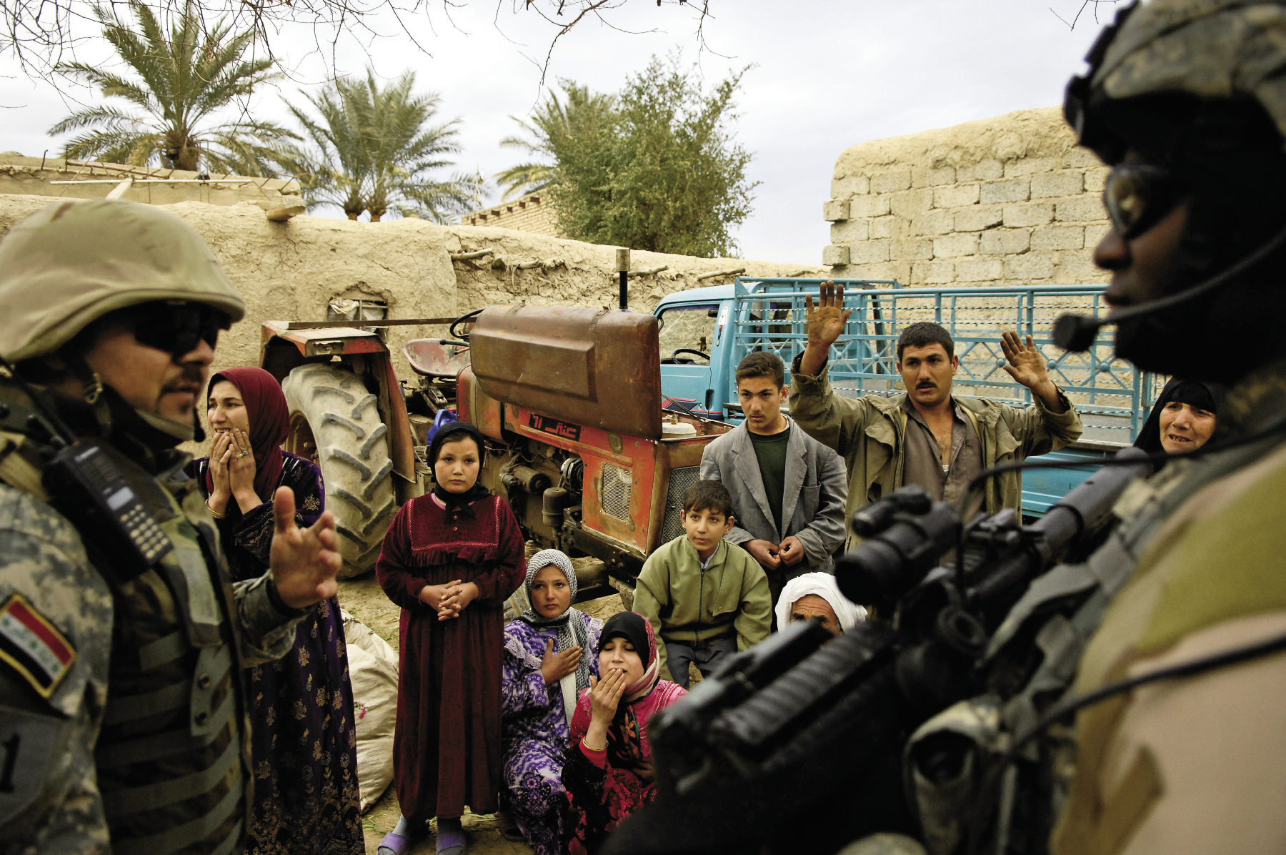 February 10, 2007: While searching for al-Qaeda and Ansar al-Sunna forces during Operation Orange Justice in Buhriz, Iraq, members of the Multi-Iraqi Transitional Team, 4th Battalion, 2nd Brigade, 5th Division question the locals.
