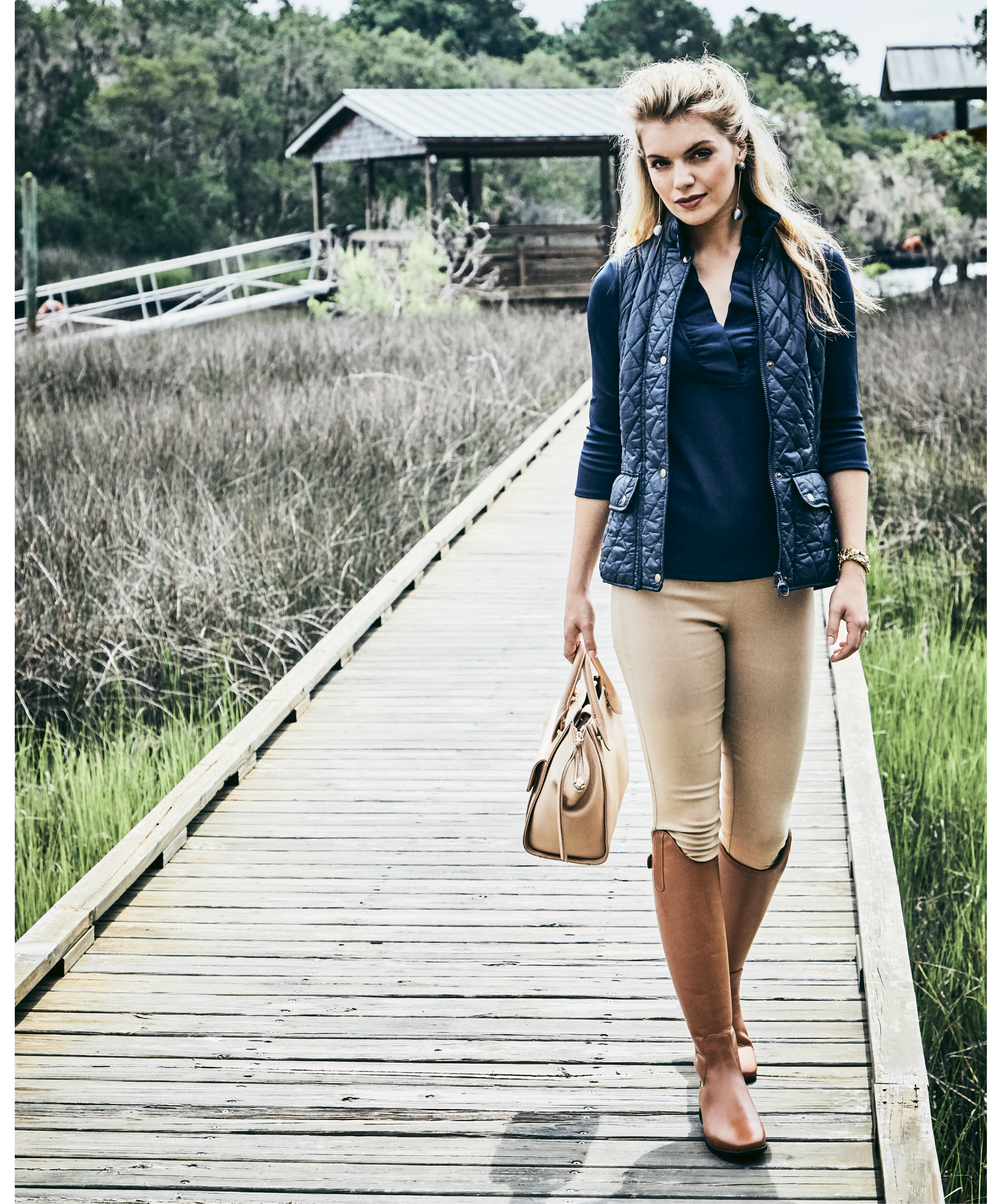 """Vest Dressed - Gretchen Scott jersey """"Ruffneck"""" top in """"navy,"""" $99, and Gretchen Scott spandex pant, $109, both at Gretchen Scott; Barbour """"Otterburn Gilet"""" vest in """"navy,"""" $129 at M. Dumas & Sons; Modern silver ball drop earrings, $38 at Tara Grinna Swimwear; estate 14K gold, sapphire, and pearl bracelet, $8,500 at Croghan's Jewel Box; Sommer """"Athen"""" tall leather boots, $300 at Bits & Pieces."""