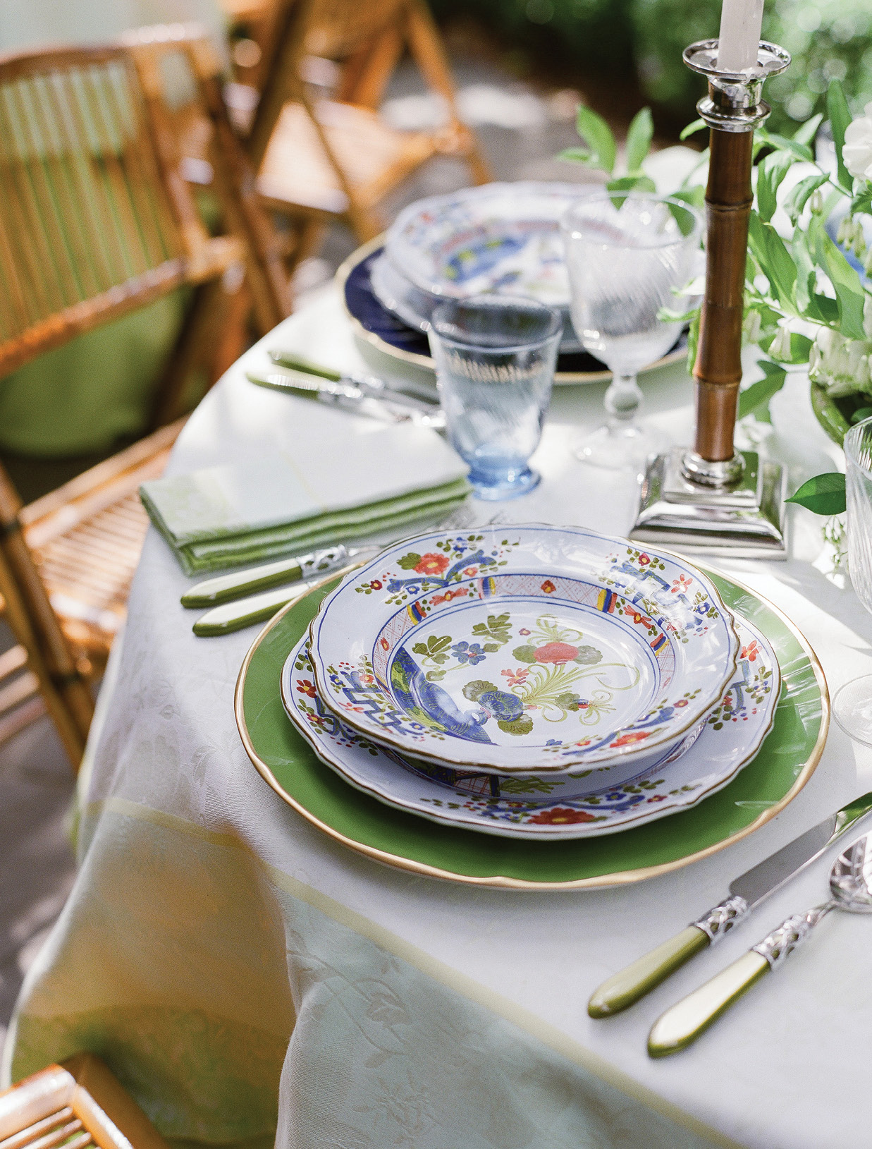"Each place setting pairs the Italian plates and bowls she and Dean selected when they were first married with bright chargers and Vietri utensils. ""We have beautiful family silver that we use for more traditional dinners,"" says Lynn, ""but the colorful cutlery just says, 'Fun!''"