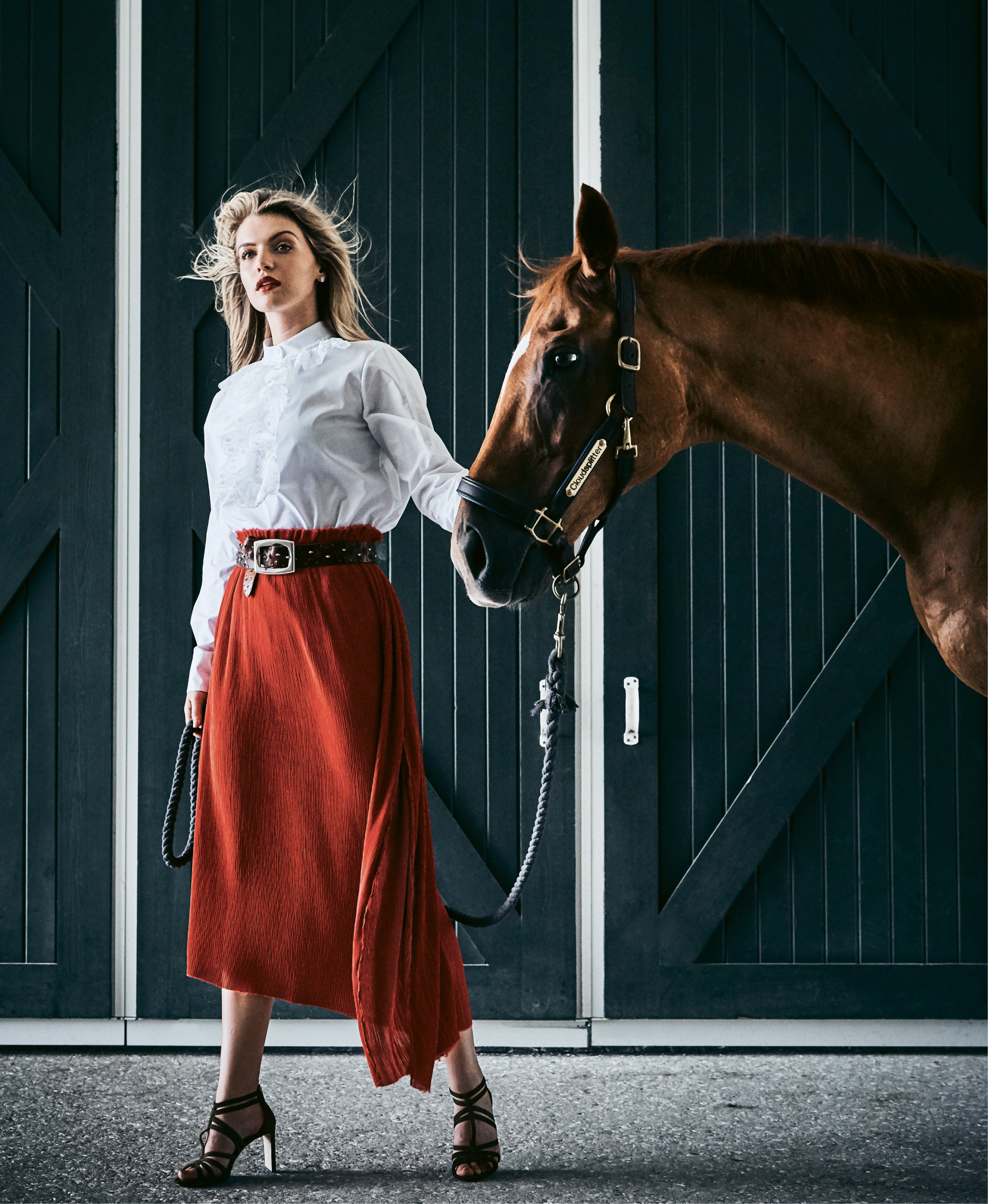 """Taking the Lead - Chloé embroidered poplin blouse, price upon request at RTW; Verandah silk-blend midi skirt, $228 at Maris DeHart; Suzi Roher leather belt, $462, and Jimmy Choo """"Selina"""" suede sandal, $850, both at Gwynn's of Mount Pleasant; Spartina 449 """"Night & Day"""" crystal earrings, $24 at Woodhouse Day Spa.  Pictured with Cloudsplitter (owned by Shelby de Freitas)"""