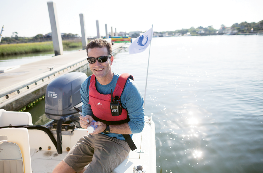 Charleston's Waterkeeper Andrew Wunderley taking water samples on Shem Creek