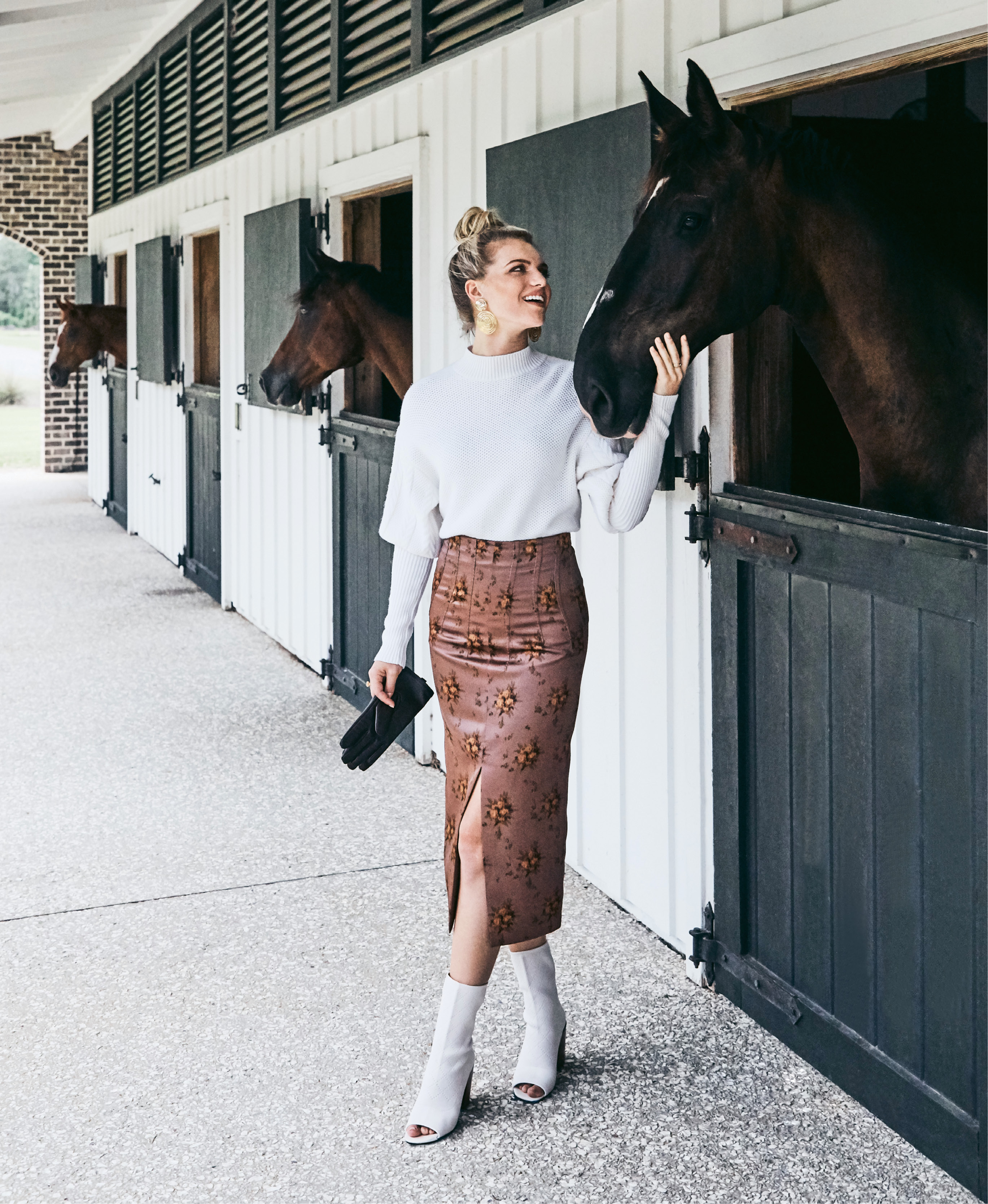 """Good Neighbors - Jonathan Simkhai wool puff-sleeve sweater in """"ivory,"""" $378 at Berlin's for Women; Brock Collection """"Sorrel"""" skirt, price upon request at RTW; Kelsi Dagger Brooklyn """"Macey"""" knit peep-toe bootie in """"vanilla,"""" $160 at Shoes on King; Gas Bijoux 24K gold-plate """"Wave"""" earrings, $176 at Lori + Lulu; estate 18K gold ring, $1,335 at Croghan's Jewel Box; leather snaffle gloves, $50 at Bits & Pieces.  Pictured with (left to right) Peter Pan (owned by Olivia Johnson), Blarney (Dr. Katie Loewenstine D.V.M.), and Captain Morgan (Dorothy Knuppel)"""