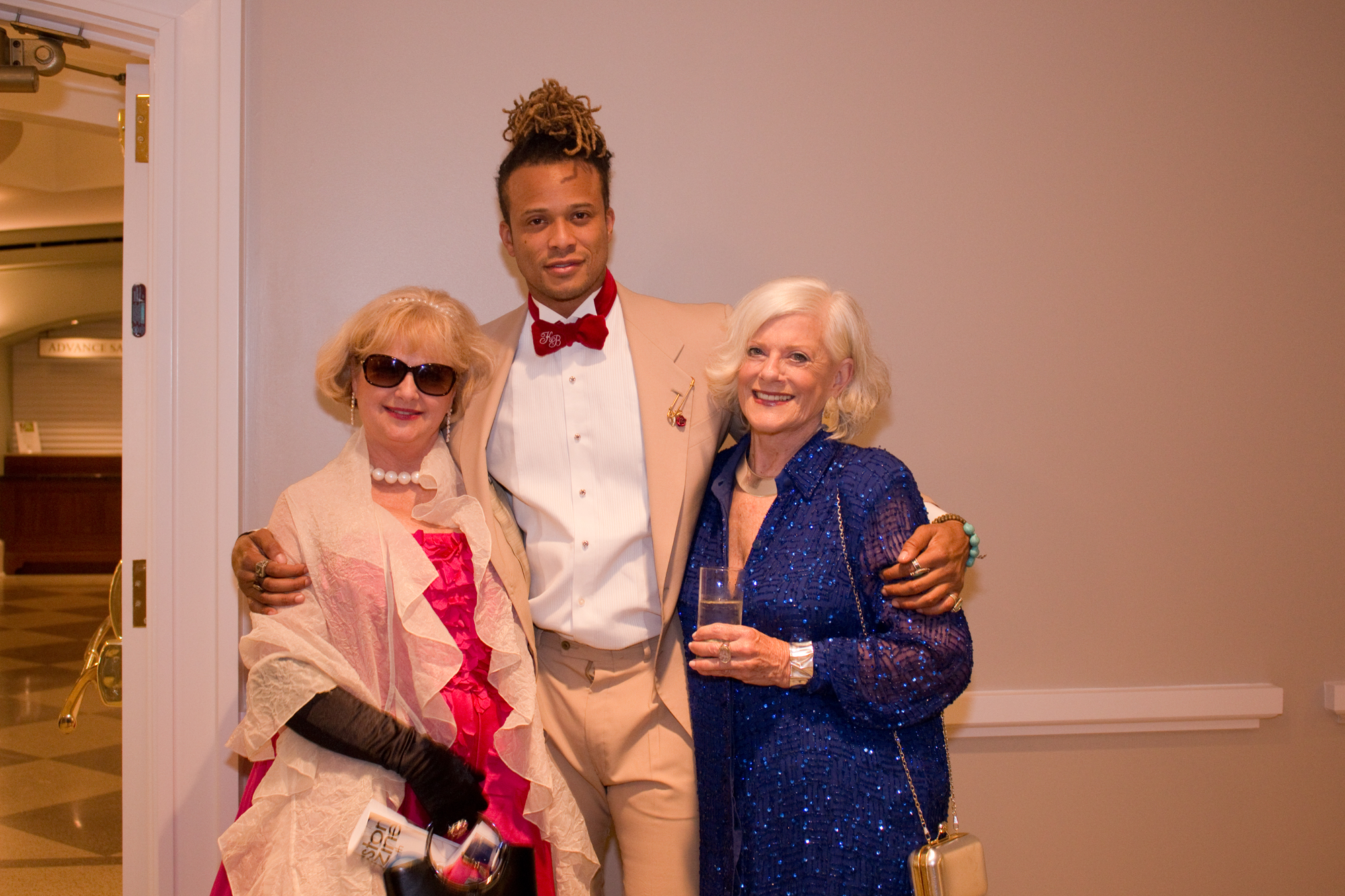 The always dapper Chelsie Ravenell with two lovely ladies