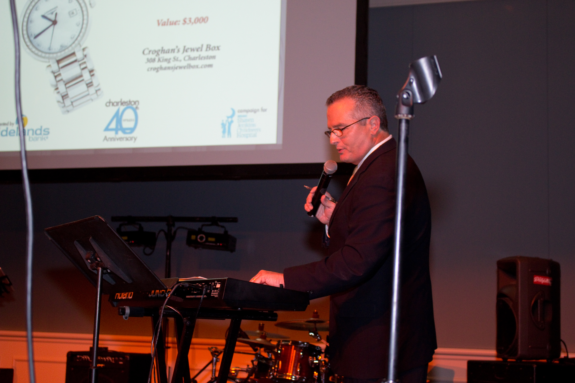 ABC News 4 anchor Dean Stephens emceed the festivities and assisted auctioneer Doug Warner in raising money for the new Children's Hospital.