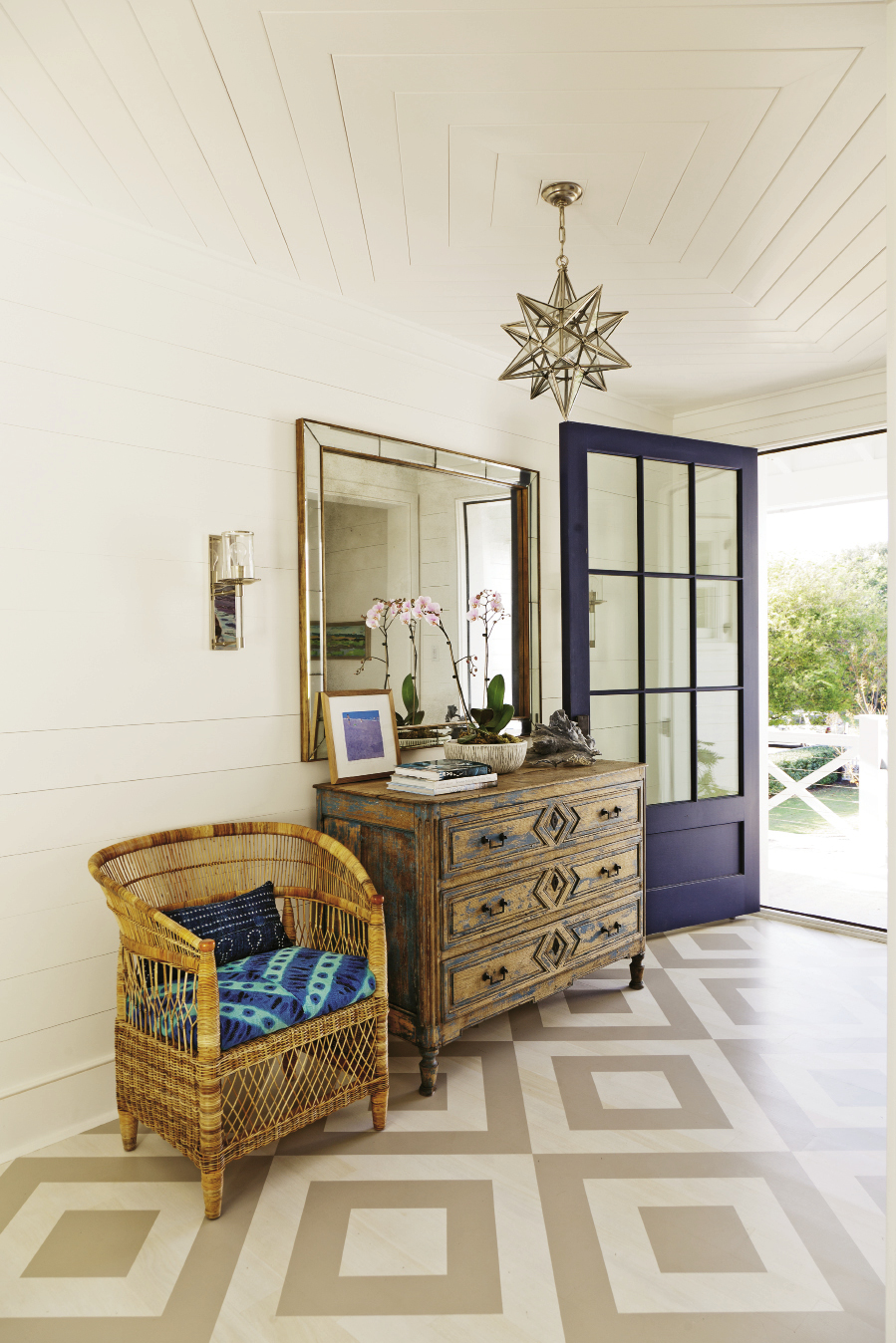 "Surfs Up: A painted foyer floor helps ""gives an unexpected punch, leading upstairs,"" says Keenan."