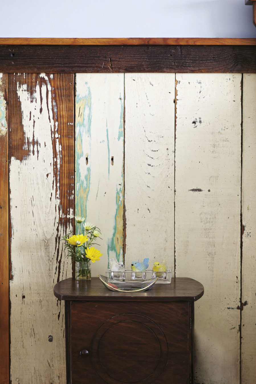 wainscotting salvaged from Greenville was left unstained to maintain its distressed look.