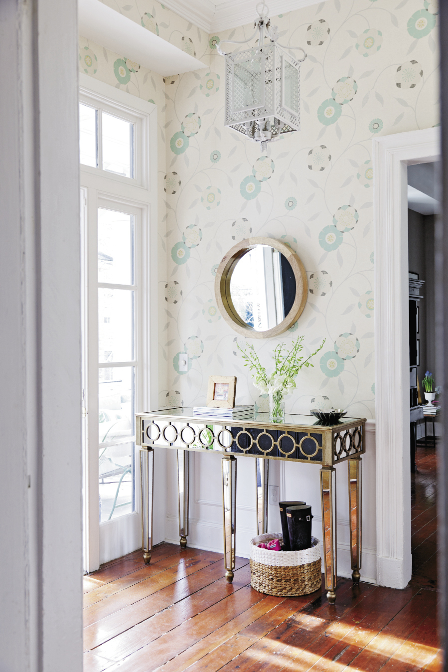 Youthful Impression Stodgy striped wallpaper was replaced with a breezy, happy pattern in Lauren and David Lails' foyer, immediately announcing that this century-old abode has spunky new life.