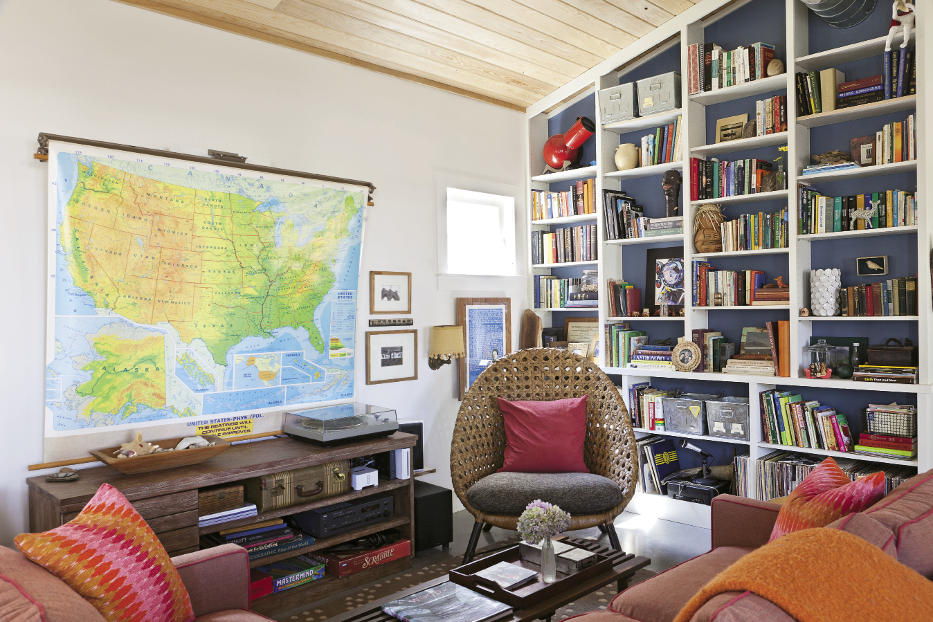 Shed roofing allows for ceilings that soar up to 14 feet in the living room; built-in shelves nod to the space-efficient houseboats that inspired the family to downsize.