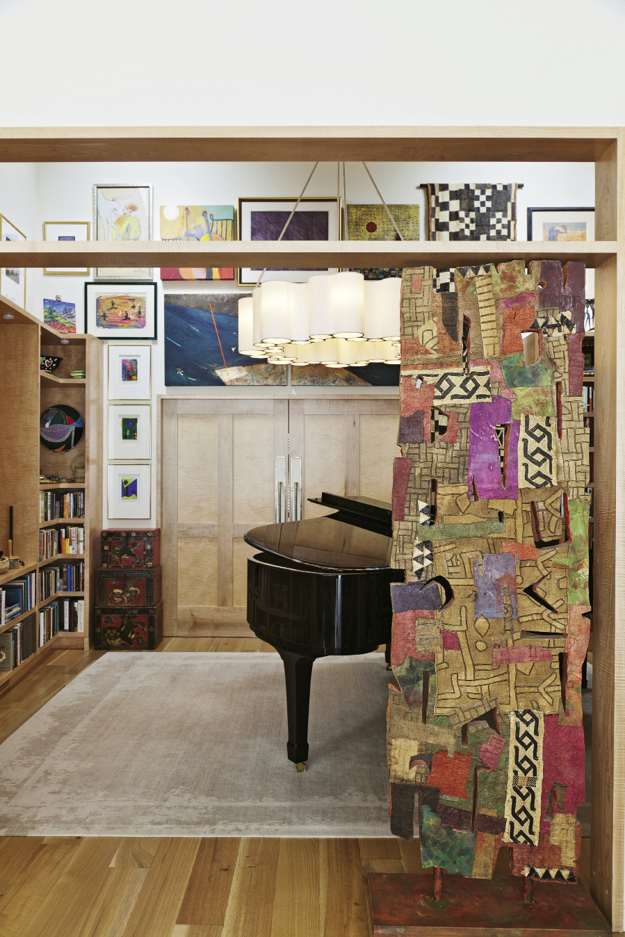 """The challenge was to have as many windows as possible, but also a lot of wall space for her art,"" Sanchez says. Many works, including the William Halsey sculpture that fits right into the doorway, found homes in this music room."