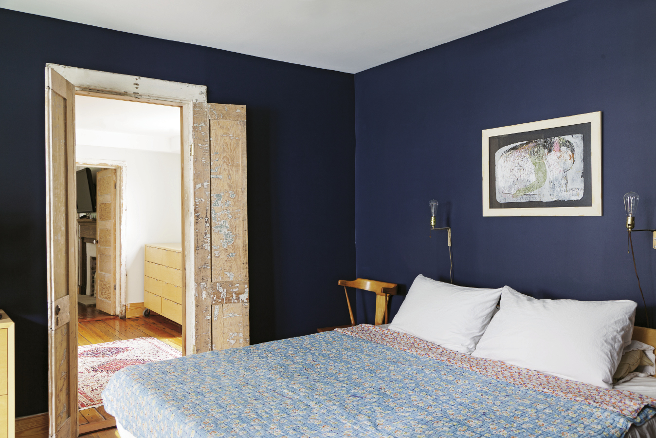 The couple's bedroom was painted navy to facilitate a good night's sleep.