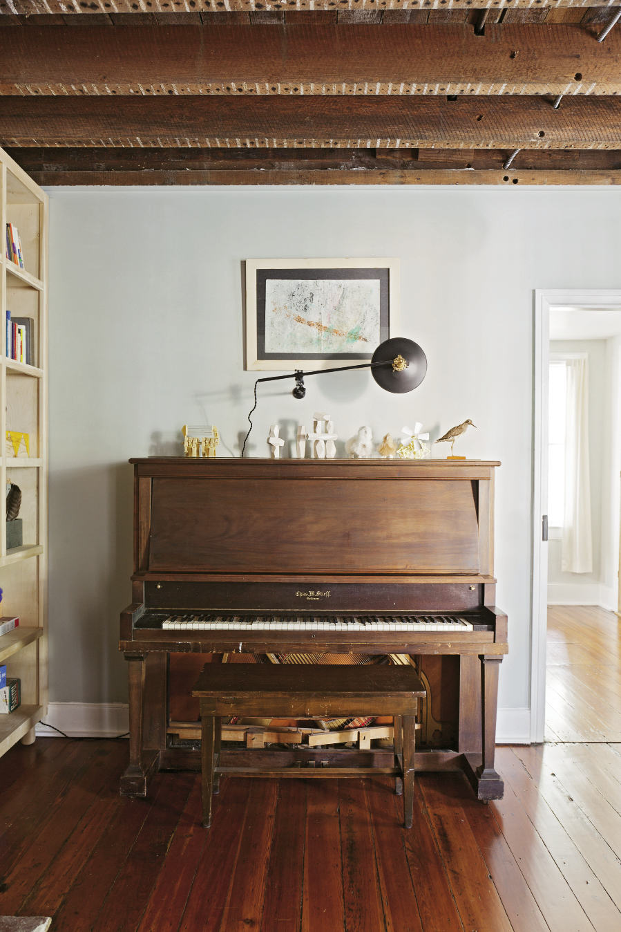A piano found for $10 on Craigslist reflect the couple's resourcefulness.