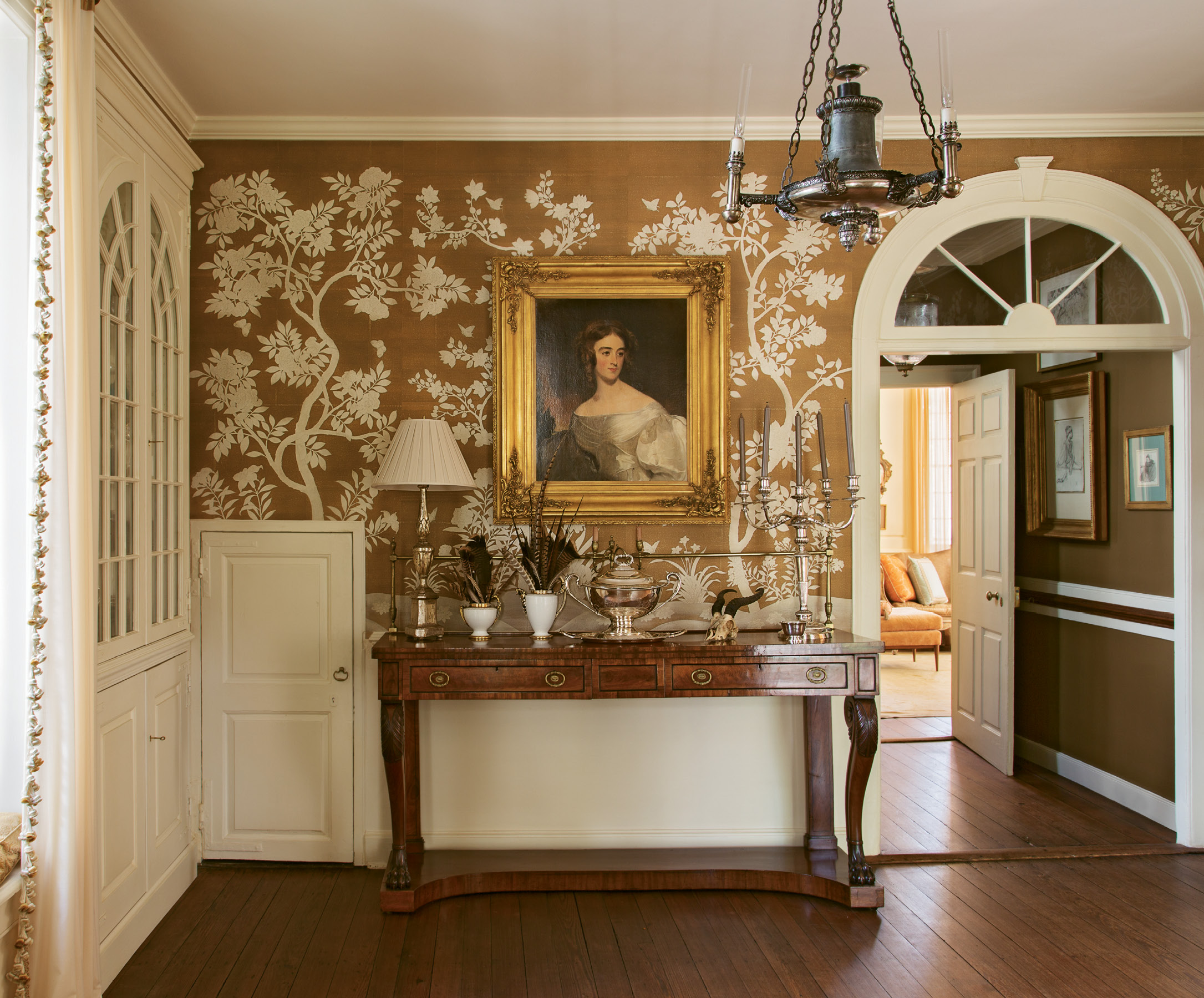 In the butler's pantry, hand-painted Gracie wallpaper complements a portrait of Mary Roane Ritchie Green by 19th-century master portrait artist Thomas Sully, who completed more than 2,000 works of wealthy patrons and politicians.
