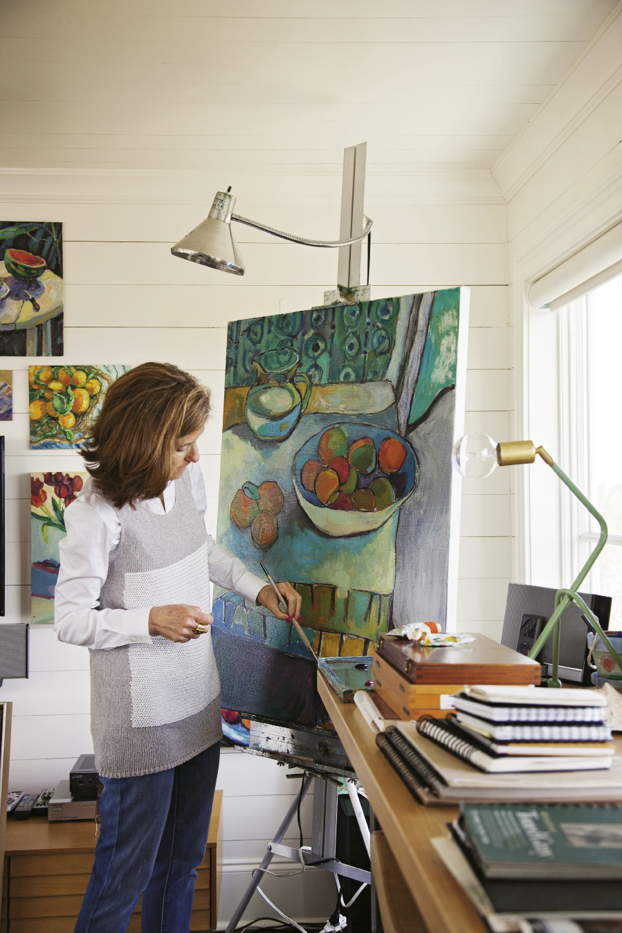 Each day, the artist spends time painting in her sunlit third-floor studio.