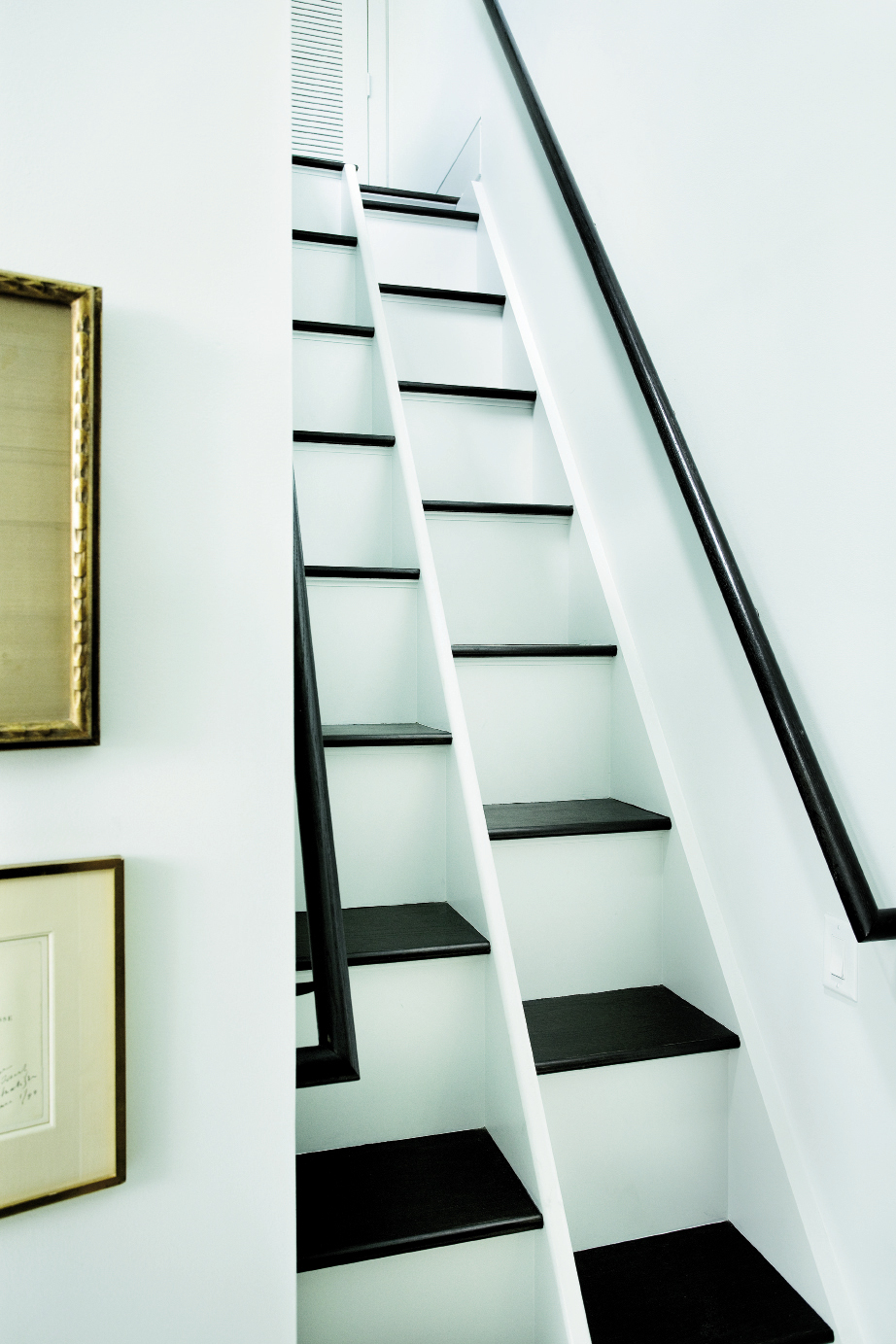 Chris designed these innovative ladder-like steps to access Kathleen's office over the master bedroom.