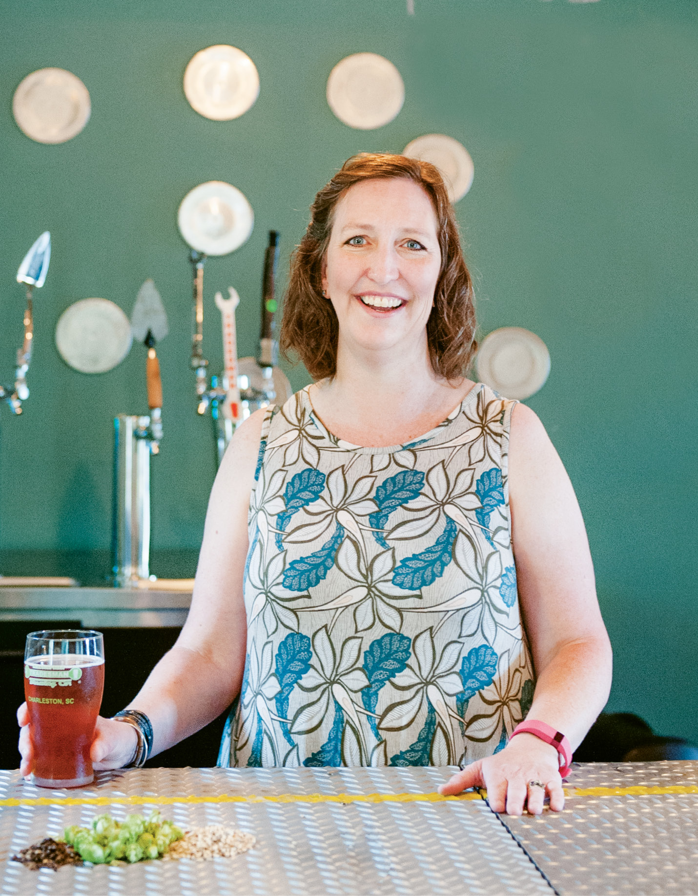 Sara Gayle McConnell behind the bar at Tradesman's upstairs taproom