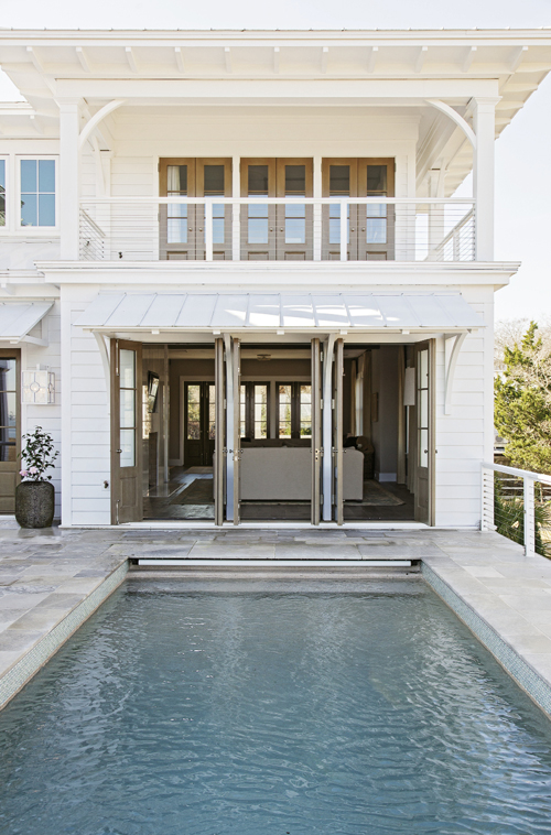 In the Swim: A wading pool graces one of four front porches; in the rear.