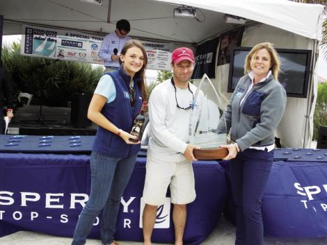 Good Sports: CORA commodore Mike Palazzo accepts the inaugural Jubilee Perpetual Sportsmanship Trophy during Race Week 2013. The award was bestowed on him and his crew for rescuing a man overboard from another boat in foul weather during the race.