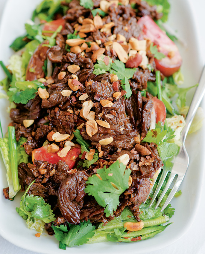 Cook's wok-seared garlic steak with Thai salad