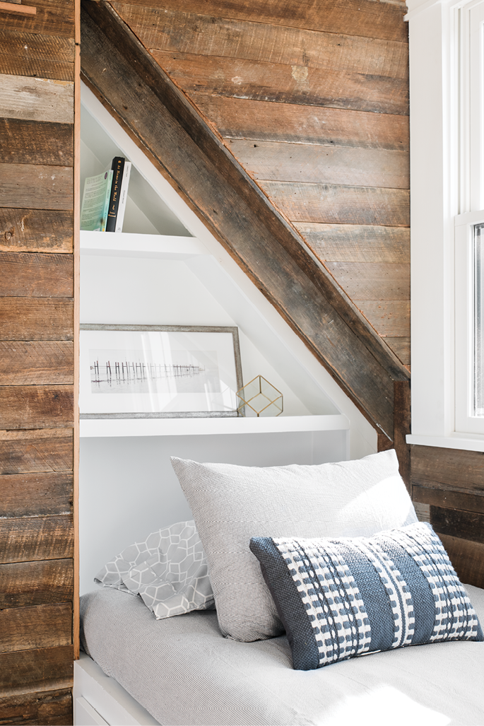 Clever Quarters: Reclaimed wood paneling and geometric built-ins strike the right balance between warm and modern in the guest space.