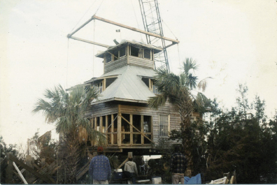 As Don Thompson's home on Goat Island was set back onto its foundation, the telephone rang.