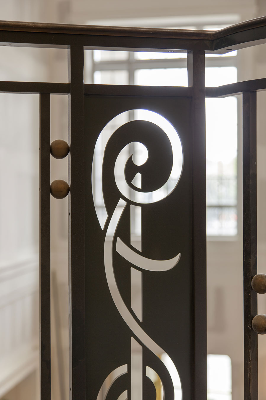 Base and treble clef notes inspired the railing designs, with much of the millwork sourced locally.
