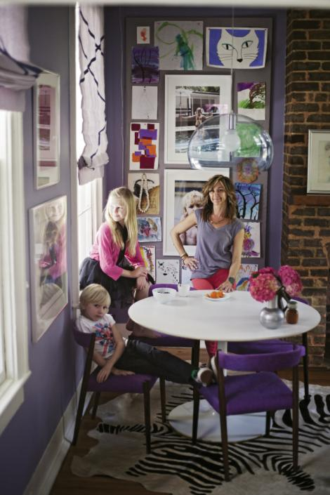 Angie, Loulou (11), and Sasha (seven) in the dining room, which is separated from the galley kitchen by a small partition. The white Tulip table is an eBay find, the chairs are 1960s Danish, and the clear globe pendant is by Kartell.