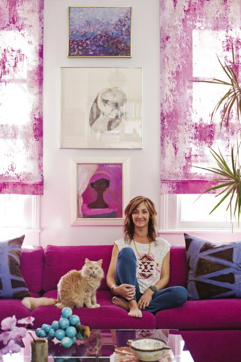 Angie (pictured with Rose the cat) re-covered this Milo Baughman sectional in a fuschia woven fabric by Glant.