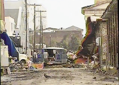 More views of the destruction downtown, including the Market littered with mud and crumpled metal debris from buildings