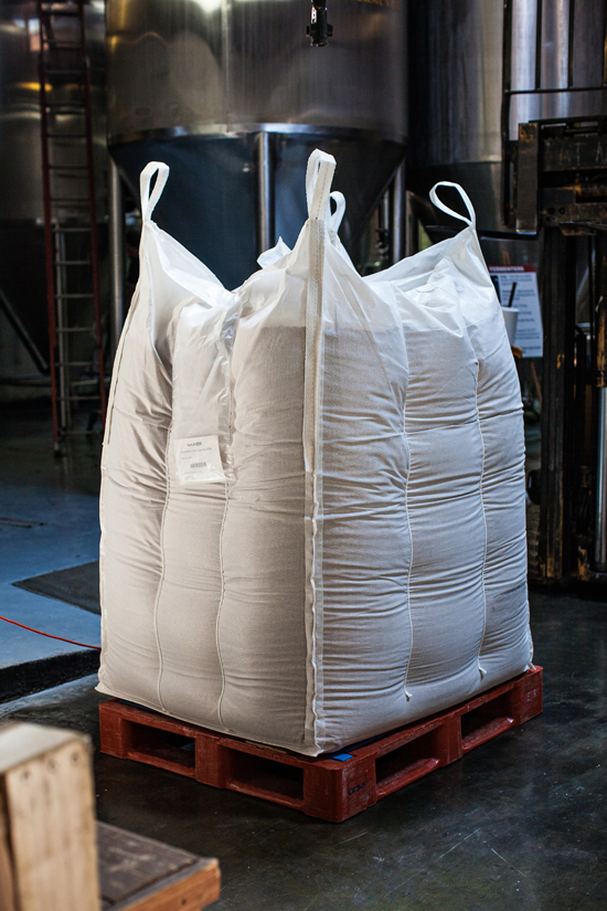 A pallet of malted barley rests waiting to be milled, and mashed