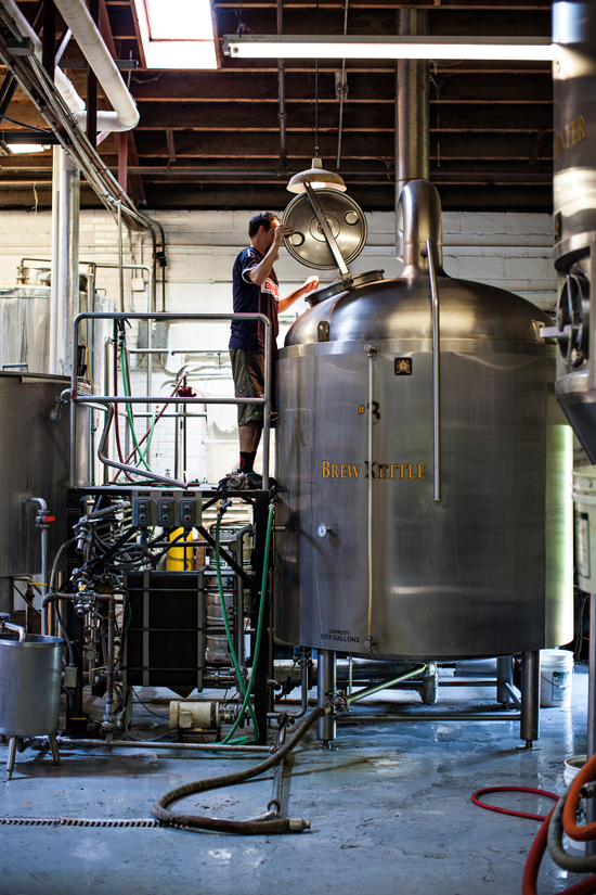 Assistant Brewer Clint Vick peers into the Brew Kettle.