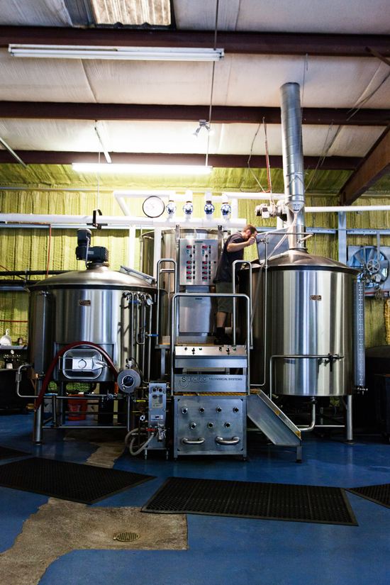 Chris Brown standing on top stands on top of Holy City's 15 bbl Brewhouse