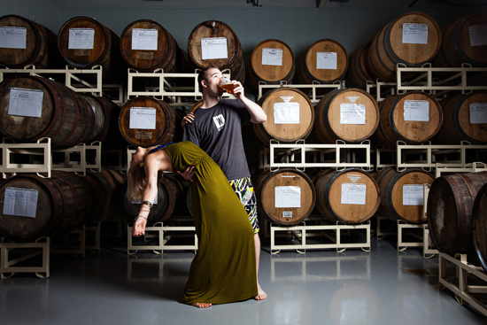 Morgan and Edward dance in the barrel aging room.