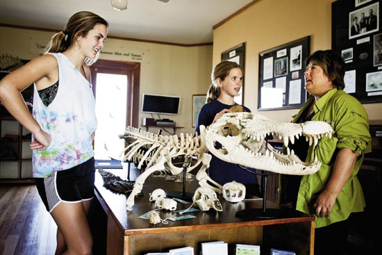 Sally (left) and Claire (middle) make a pit stop at the Nature Center, featuring a touch-tank, a live turtle exhibition, and info on barrier island ecosystems, including gator orthopedics.
