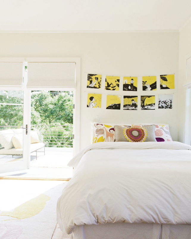 Maya's room is dressed with favorite storybook pages strung over her bed
