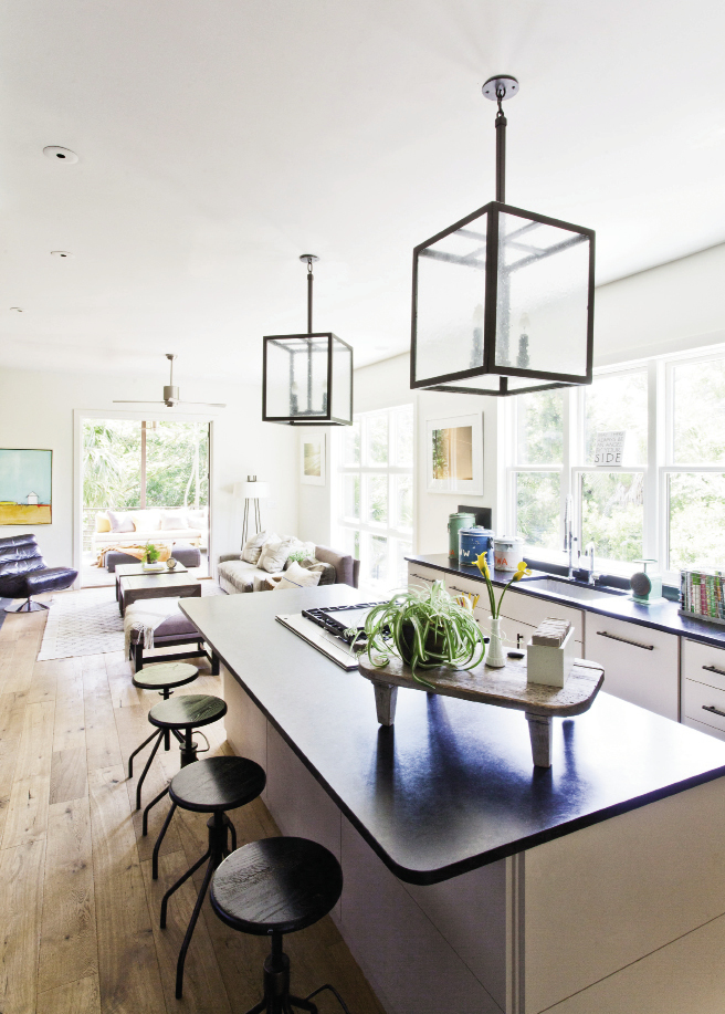 A bank of windows replace overhead  cabinetry in the kitchen.