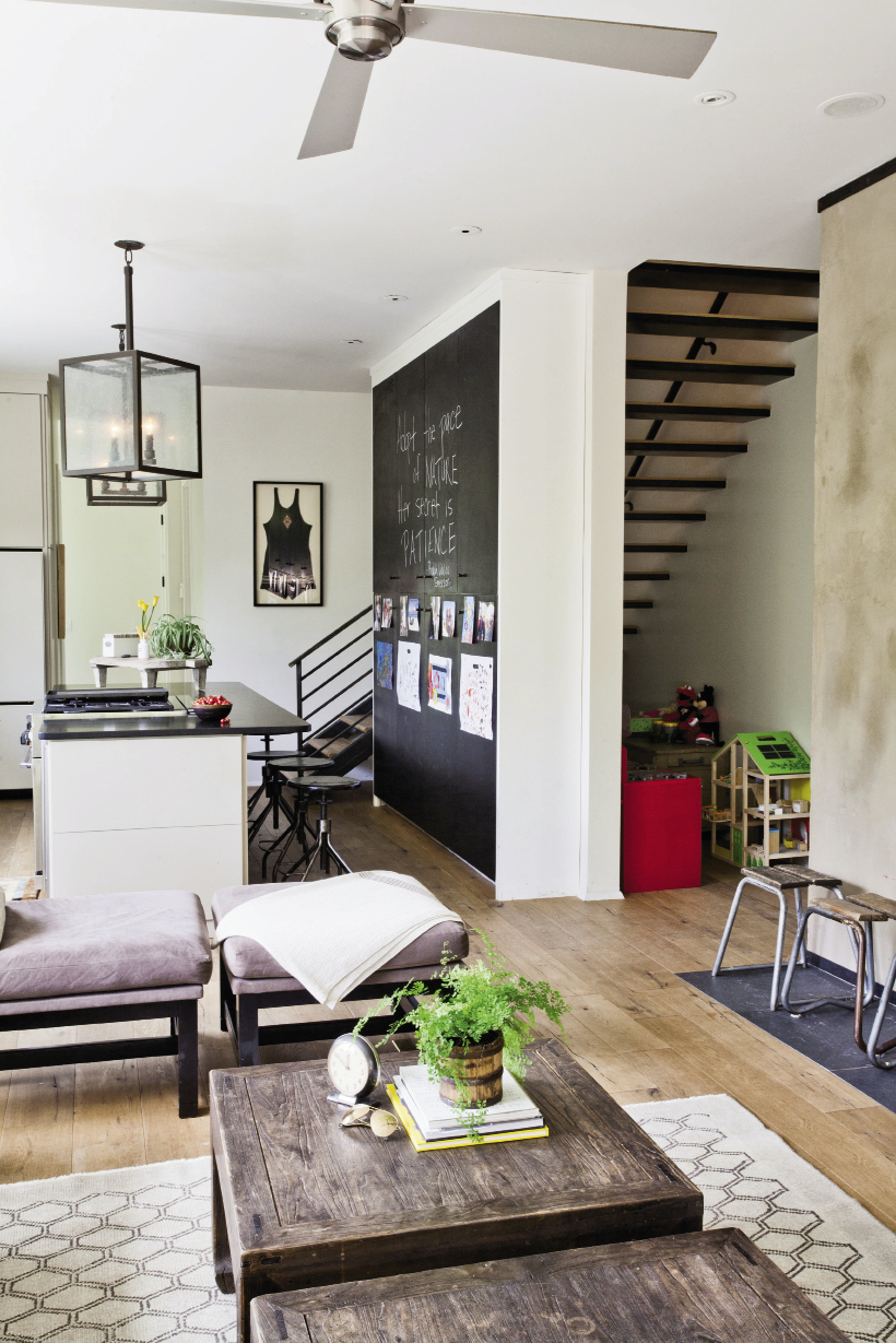"""Monica and Alex dub the kitchen cupboards—covered in blackboard paint—a """"savior."""""""