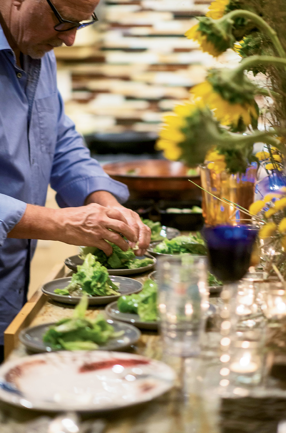 """Lettuce is prepped for a fresh side salad. """"It's all about what I have in the garden,"""" says Martin."""