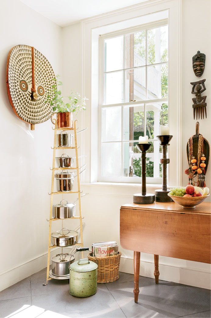 From Ethiopian carved wood candle holders to a Croatian honey pot, artifacts collected during Monica's many travels lend a global aesthetic to the interiors.