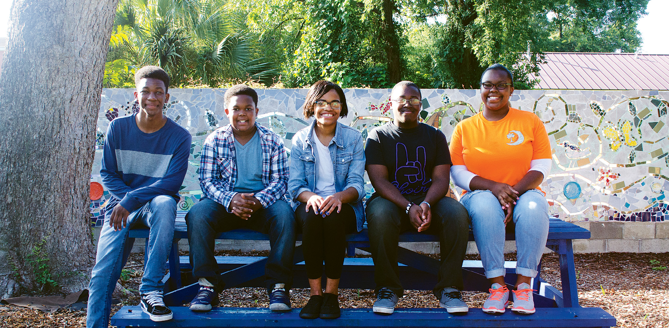 Robert Pickering III, Knicholas Pickering, Brianna Stanley, Chandler Threatt, and Reagan Pickering are among the teens who tend the downtown garden.