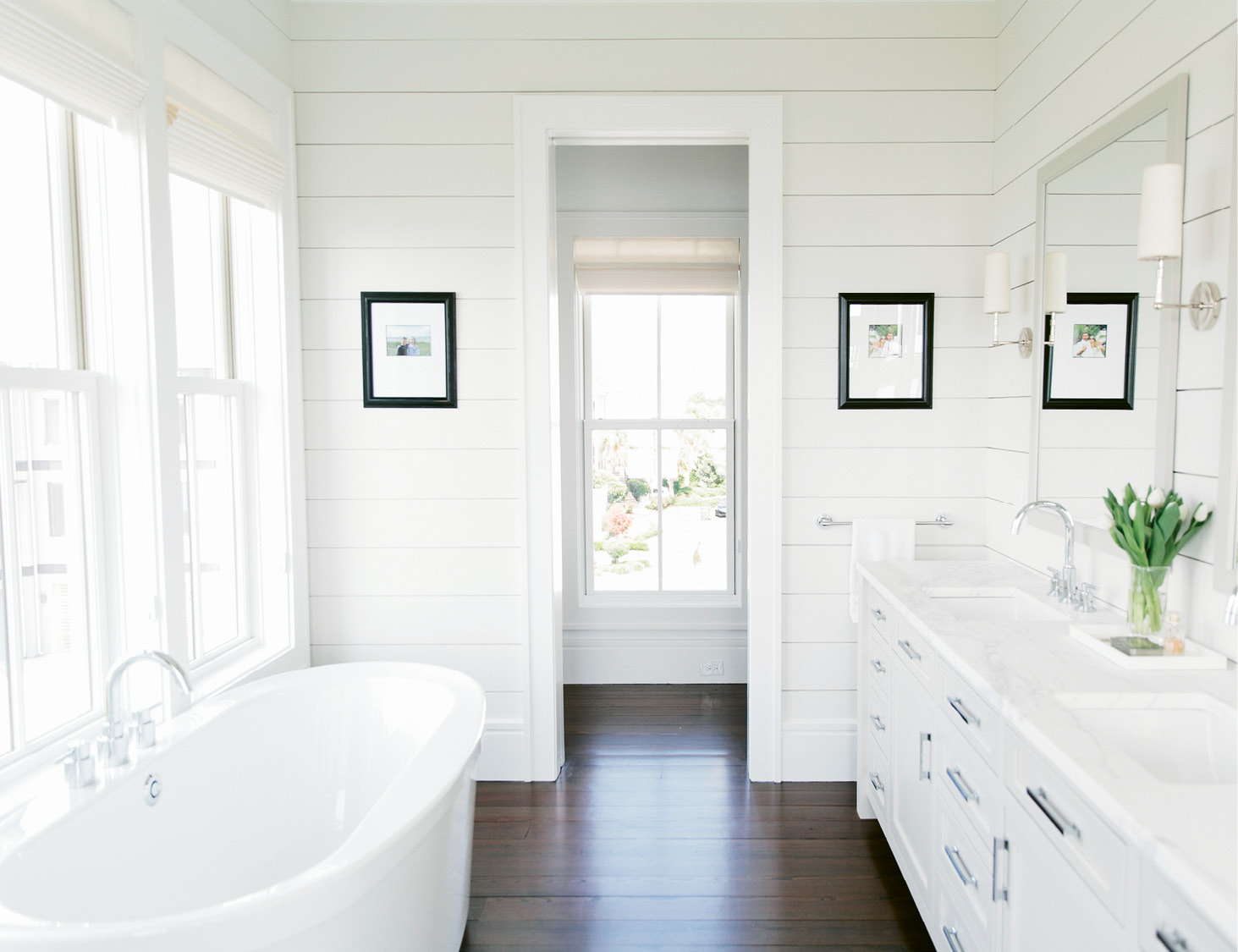 Mid-century furnishings feel clean-lined and simple, while shiplap walls in the master bath nod to coastal cottages.