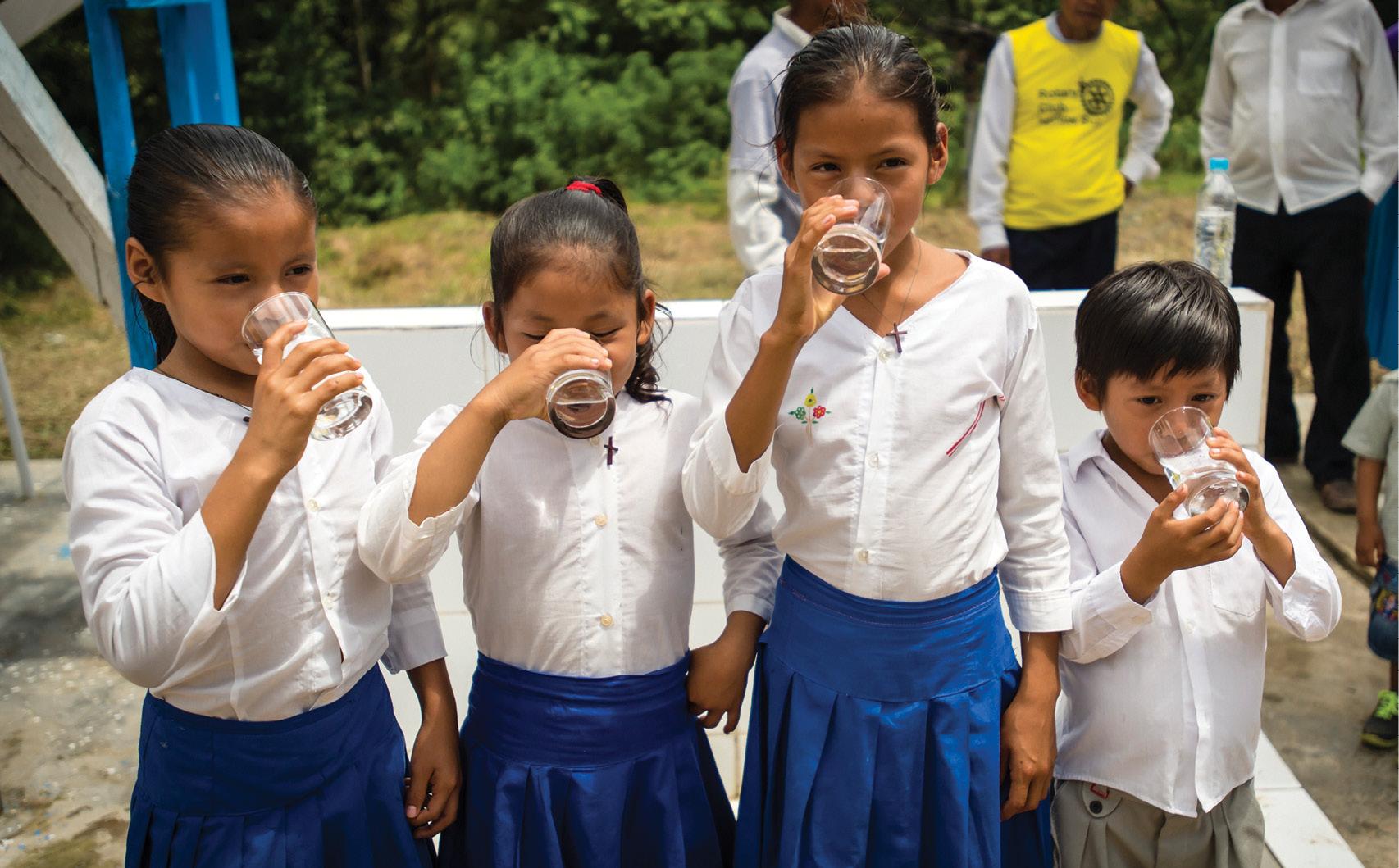 Children enjoy cool drinks in Peru
