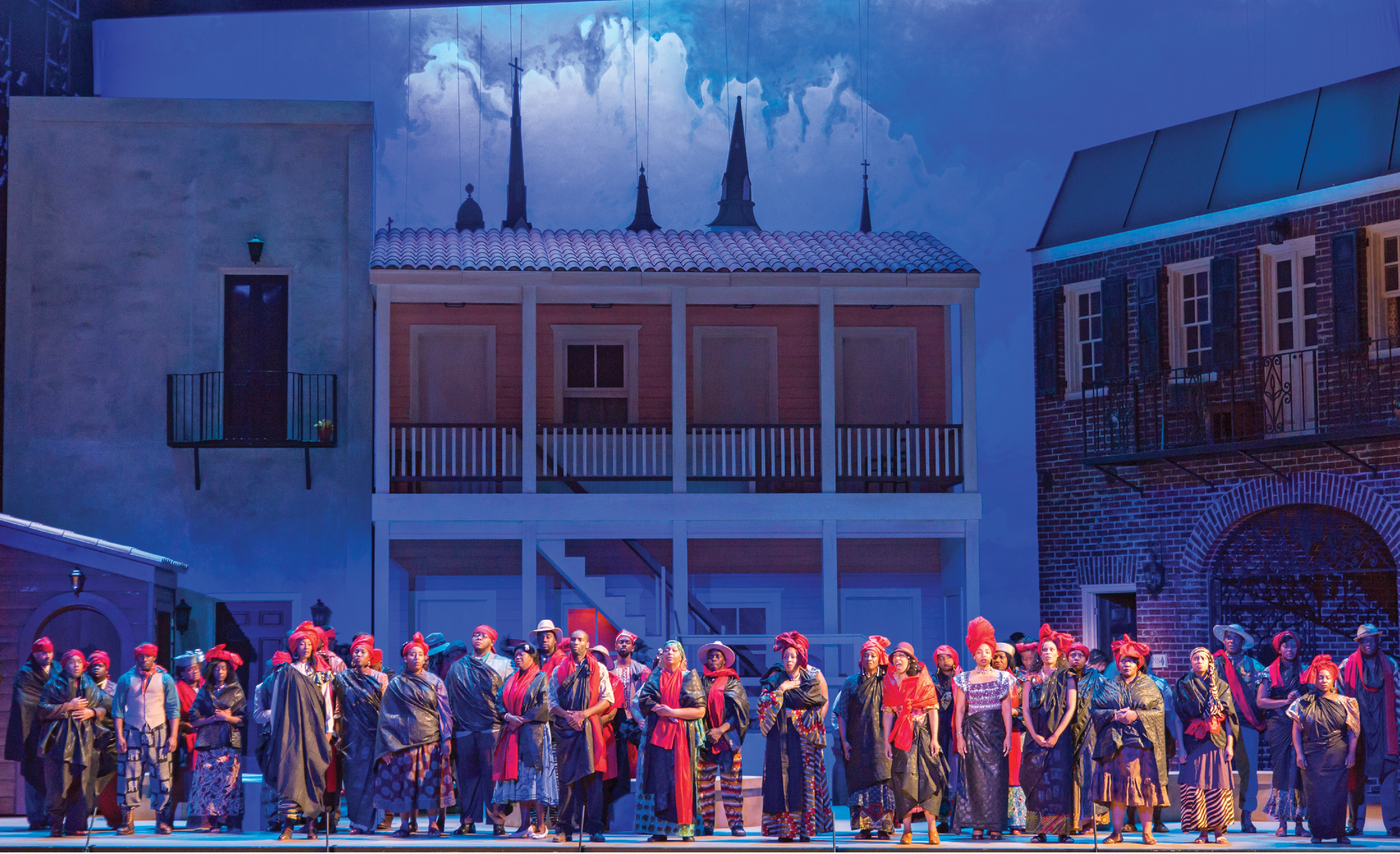 A scene from Spoleto Festival USA's 2016 production of Porgy and Bess, the premiere production that christened the new Gaillard Center and showcased the visual design of local artist Jonathan Green