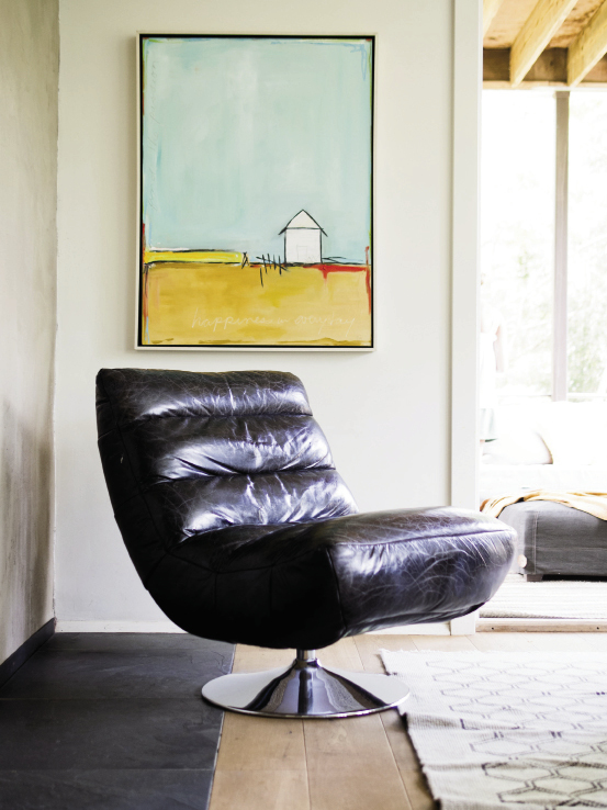 This retro  leather swivel chair gives the relaxed family room a little edge. The painting is by Aspen artist Tori Mitas-Campisi