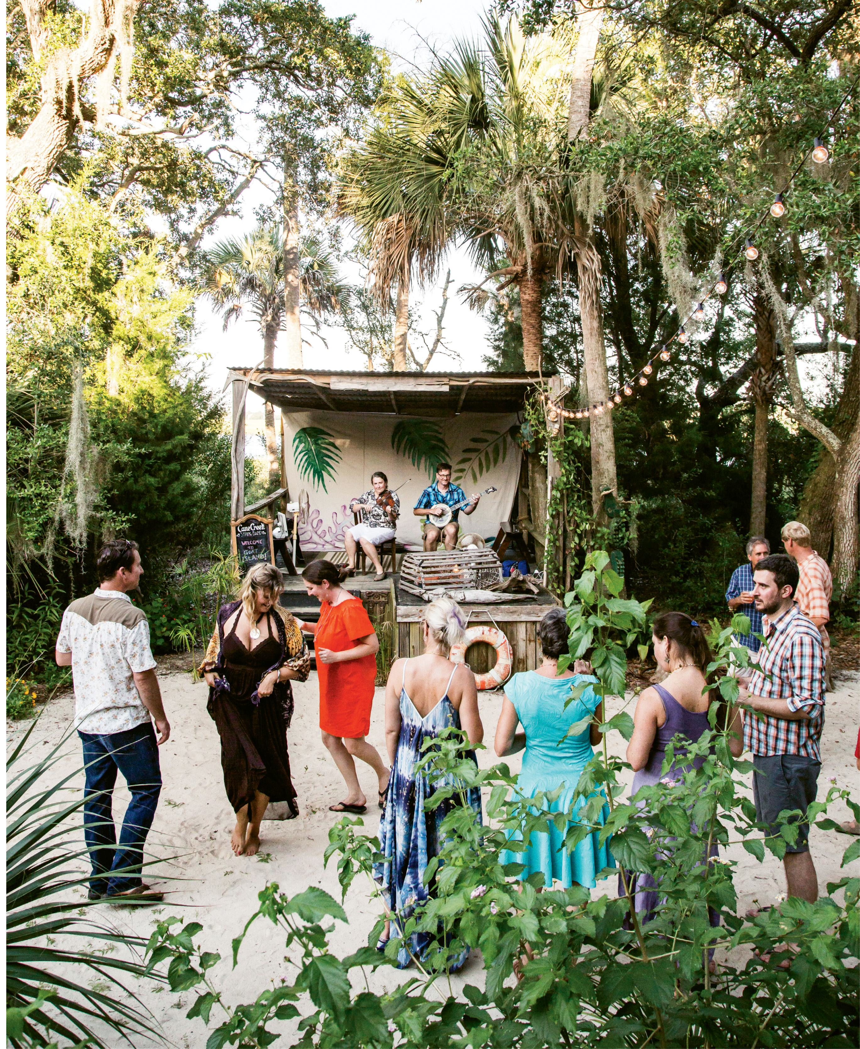 Guests sip and sway to the upbeat harmonies of Cane Creek String Band.