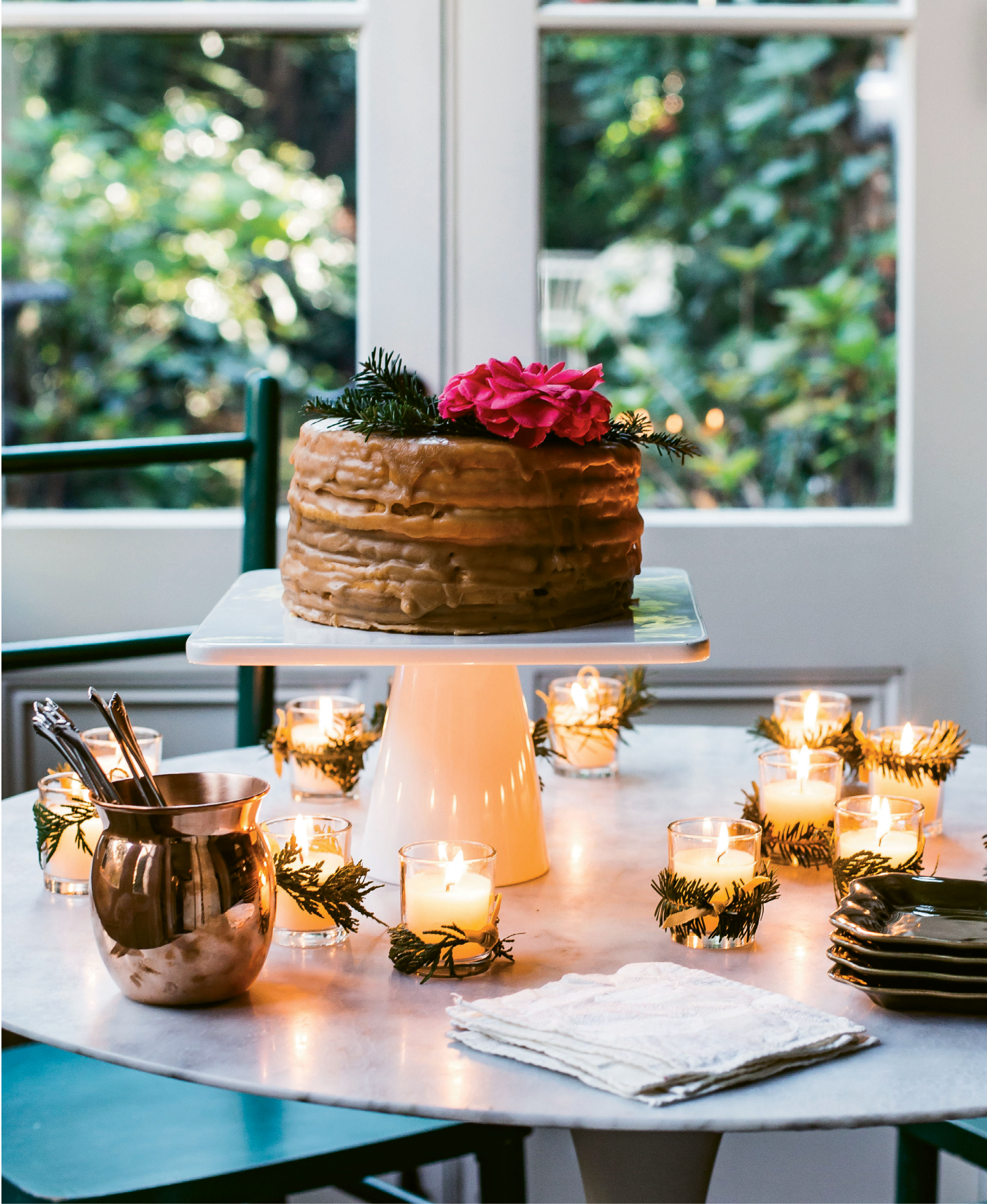 ATTENTION TO DETAIL: The right serving pieces make desserts as much a feast for the eyes as they are otherwise. Here, a home-style caramel cake from Halls Chophouse is elevated when showcased on a tall cake stand