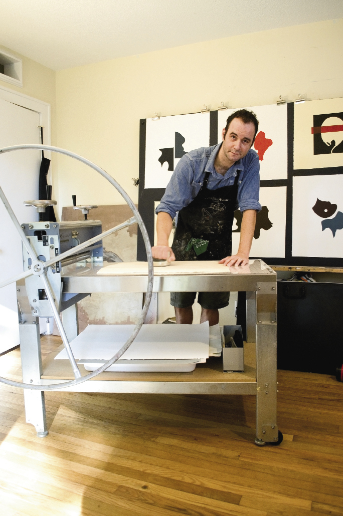 In his Avondale home studio, Ailstock creates monoprints, woodcuts, and etchings on an etching press.