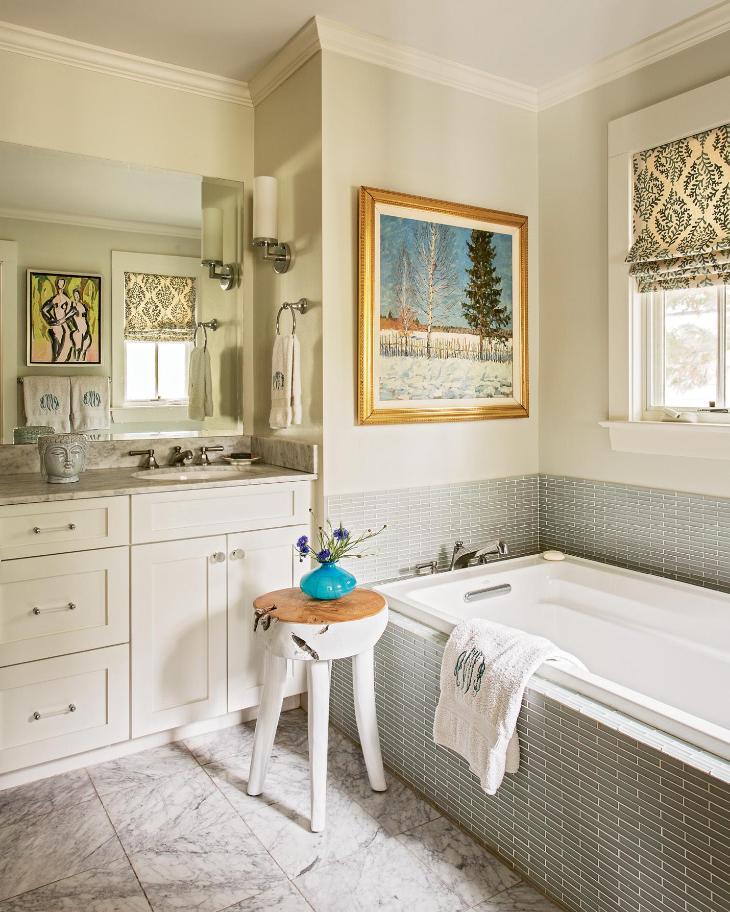 A piece by Charleston Artist Collective artist Anne Darby Parker reflects in the bath mirror.