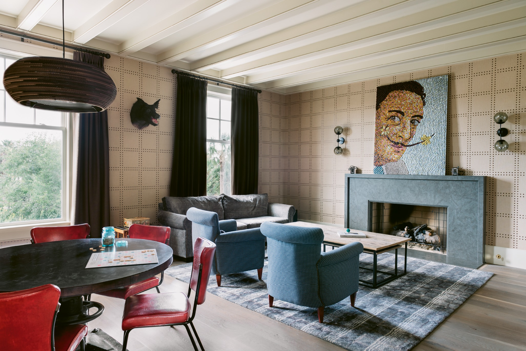 A glittering bottle-cap portrait of Salvador Dalí by local artist Molly B. Right and riveted wallpaper from Phillip Jeffries inject texture and a sense of glamour into the den.