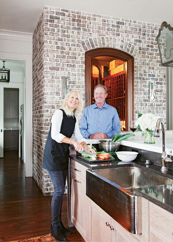 Kelly and David Lyle's kitchen is the center point of their custom Shingle-style home designed by Herlong & Associates.
